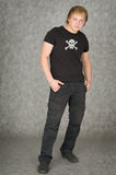 Man in a T-shirt with pirate symbolics. The man in a T-shirt with pirate symbolics Royalty Free Stock Images