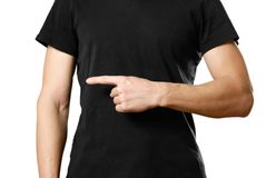 A man in a t-shirt pointing to the side. Close up. Isolated background royalty free stock photos