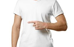 A man in a t-shirt pointing to the side. Close up. Isolated background royalty free stock photography