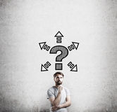 Man in T-shirt and question mark with arrows Royalty Free Stock Photo