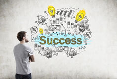 Man in T-shirt and success icons Royalty Free Stock Photos