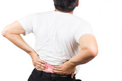 Man in t-shirt suffering from lower back pain Stock Images