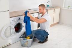 Man With T-shirt While Using Washing Machine stock photography