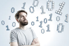 Man in T-shirt, zeros and ones Stock Photo
