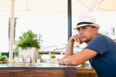 Man at a table in a cafe Stock Photography
