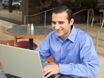 Man at table with laptop Royalty Free Stock Photos