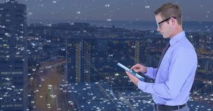 Man on tablet against Night city with connectors. Digital composite of Man on tablet against Night city with connectors Stock Image