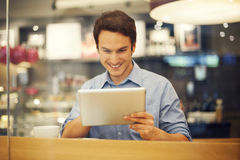 Man with tablet in cafe Royalty Free Stock Images