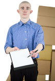 Man with tablet and carton boxes Royalty Free Stock Photo