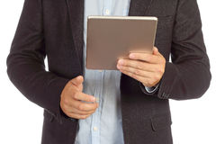 Man with tablet close-up in black suit. Man with tablet isolated on white background Stock Image