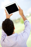 Man with a tablet computer Royalty Free Stock Images