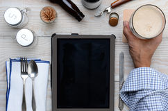 Man Tablet Computer and Beer Royalty Free Stock Photography