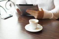 Man with tablet computer reading news at motning Stock Images