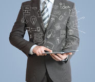 Man with tablet in hands and business sketches Stock Image