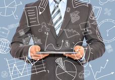 Man with tablet in hands and business sketches Stock Photo