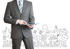 Man with tablet in hands and business sketches Royalty Free Stock Image