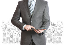 Man with tablet in hands and business sketches Royalty Free Stock Images