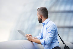 Man with tablet. Handsome young man with tablet in the streets of London Stock Photo