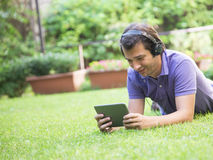 Man tablet headphones internet Royalty Free Stock Photos