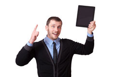 Man with a tablet in his hand and raised finger up, isolated on white Royalty Free Stock Images