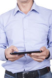Man with tablet in his hands. Stock Photos