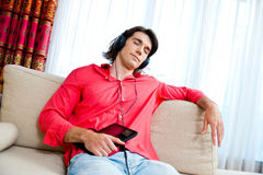 Man with tablet listen music Royalty Free Stock Photos