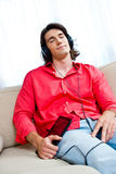Man with tablet listen music Royalty Free Stock Images