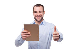 Man with tablet makes a gesture thumb up Royalty Free Stock Images