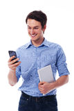 Man with tablet and mobile phone Stock Image