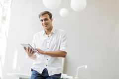 Man with tablet in the office Stock Photography