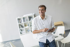 Man with tablet in the office Royalty Free Stock Image