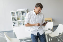 Man with tablet in the office Royalty Free Stock Images