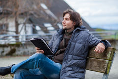 Man with tablet outdoor Stock Images