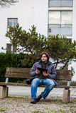 Man with tablet outdoor Stock Photography