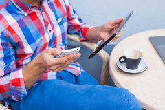 Man with tablet pc and coffee in cafe. Man with tablet pc and coffee in cafe Stock Photos