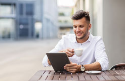 Man with tablet pc and coffee at city cafe Royalty Free Stock Photos