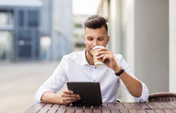 Man with tablet pc and coffee at city cafe Stock Photography