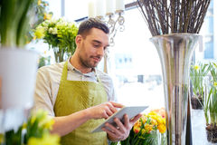Man with tablet pc computer at flower shop Stock Images