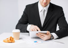 Man with tablet pc and cup of coffee. Close up of man with tablet pc and cup of coffee Royalty Free Stock Photos