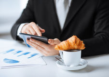 Man with tablet pc and cup of coffee. Close up of man with tablet pc and cup of coffee Royalty Free Stock Images