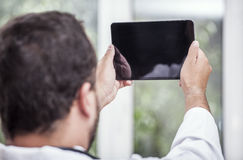 Man with a Tablet PC. Doctor holding a Tablet PC Stock Photography