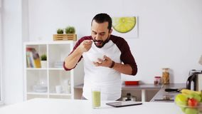 Man with tablet pc eating breakfast at home stock footage