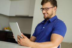 Man with tablet pc at home Royalty Free Stock Photo
