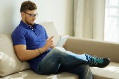 Man with tablet pc at home Stock Photography
