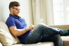 Man with tablet pc at home Royalty Free Stock Image