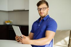 Man with tablet pc at home Stock Photo
