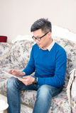 Man Tablet PC at home Stock Image