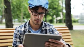 Man with tablet pc sitting on city street bench 10 stock footage