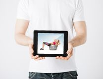 Man with tablet pc and sporty woman Stock Image