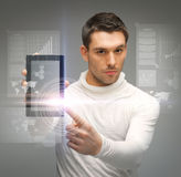 Man with tablet pc and virtual screens Stock Photos